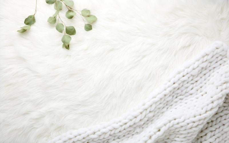 A white weighted blanket