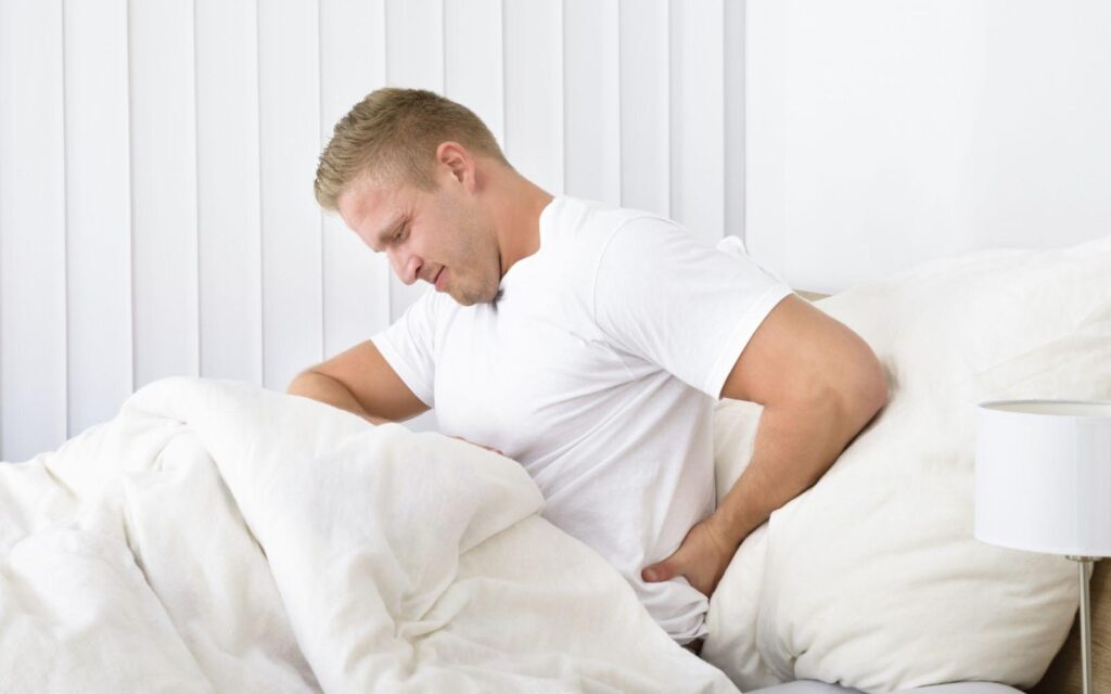 How can a bad back affect your sleep?