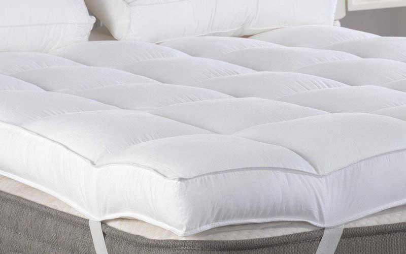 How can I make my guest bed more comfortable?
