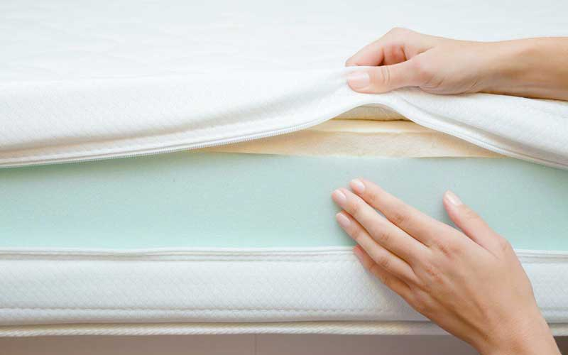What causes that new-mattress smell?