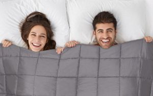 happy-couple-in-bed